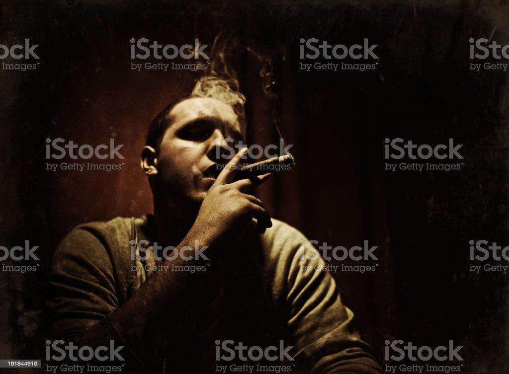 young guy smoking a cuban cigar stock photo