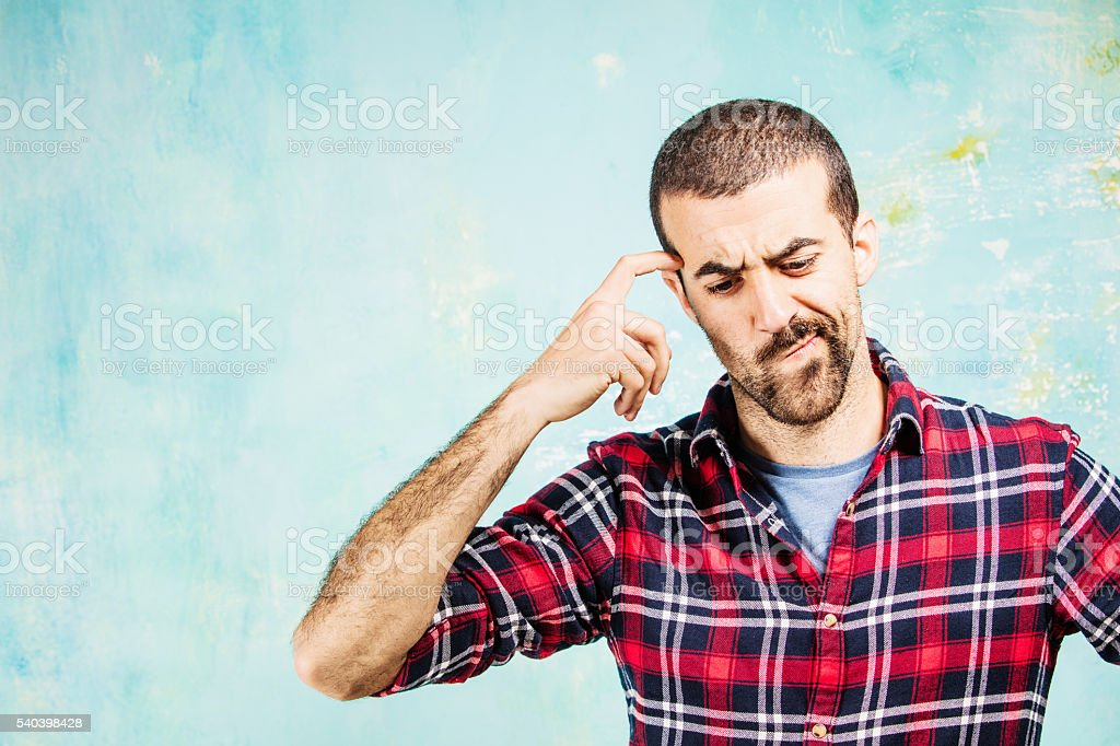 Young guy thinking and reflecting about severe problems stock photo