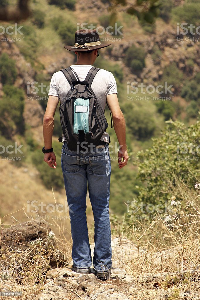 Young guy traveling nature with backpack royalty-free stock photo