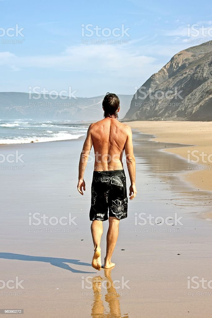 Young guy walking on the beach - Royalty-free Adult Stock Photo