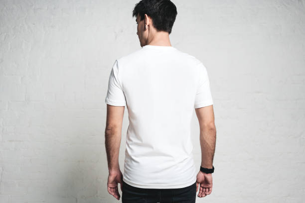 Young guy wearing blank white t-shirt, back side, horizontal studio portrait stock photo