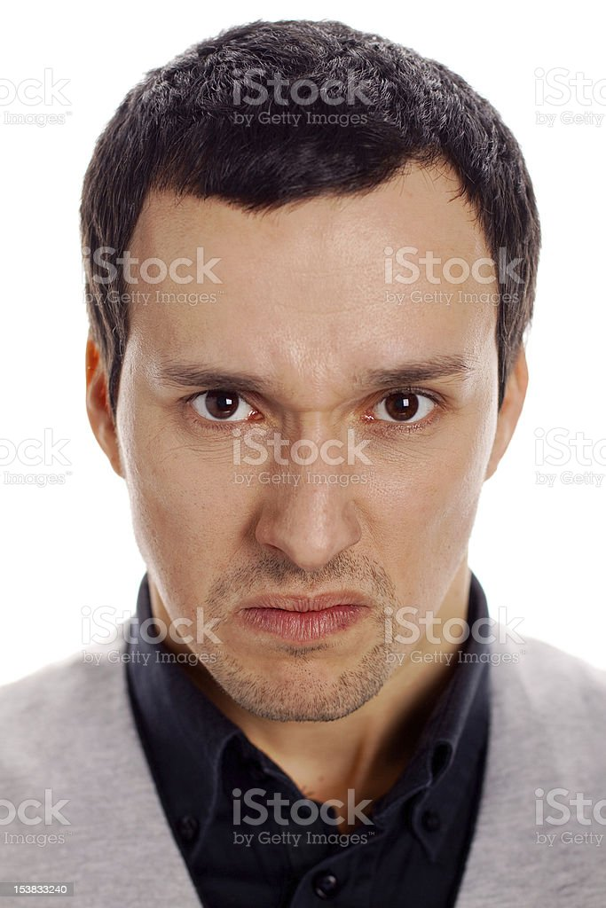 young guy with an angry expression on his face royalty-free stock photo