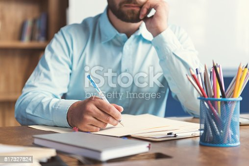 istock Young guy with beard doing test for candidates in office 817327824