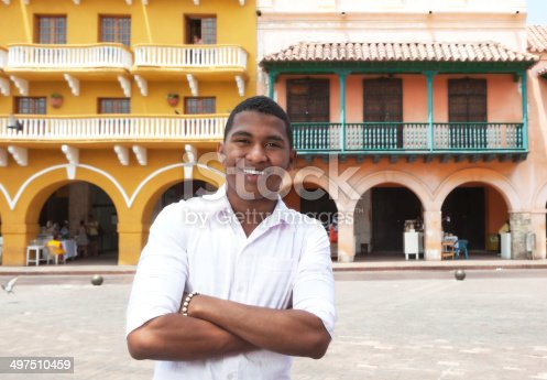 istock Young guy with crossed arms in a colonial town 497510459