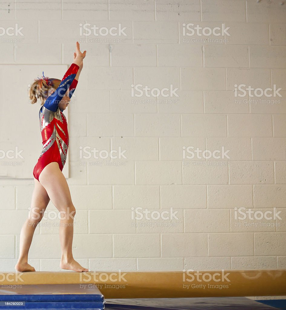 Young Gymnast Doing Balance Beam Routine royalty-free stock photo