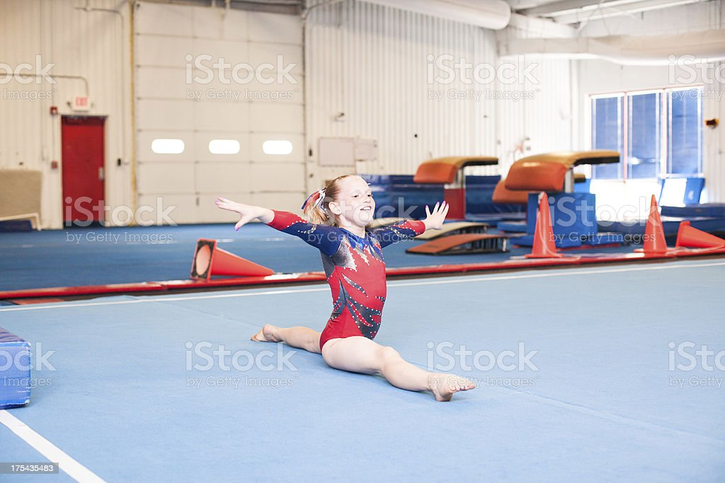 Young Gymnast Doing Floor Routine stock photo