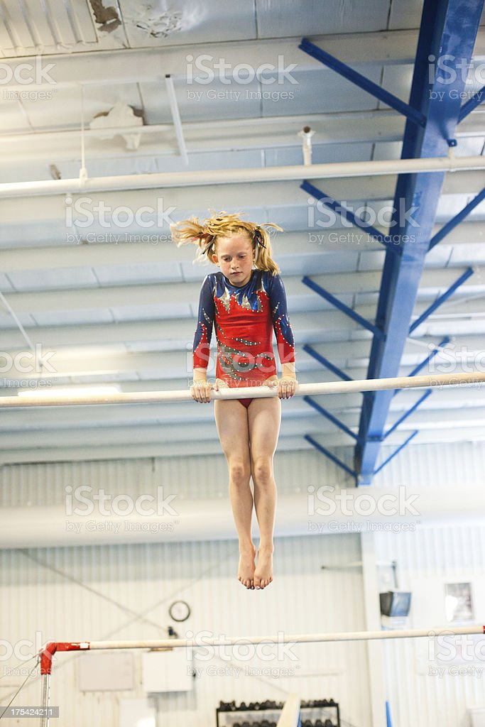 Young Gymnast on the Uneven Bars royalty-free stock photo
