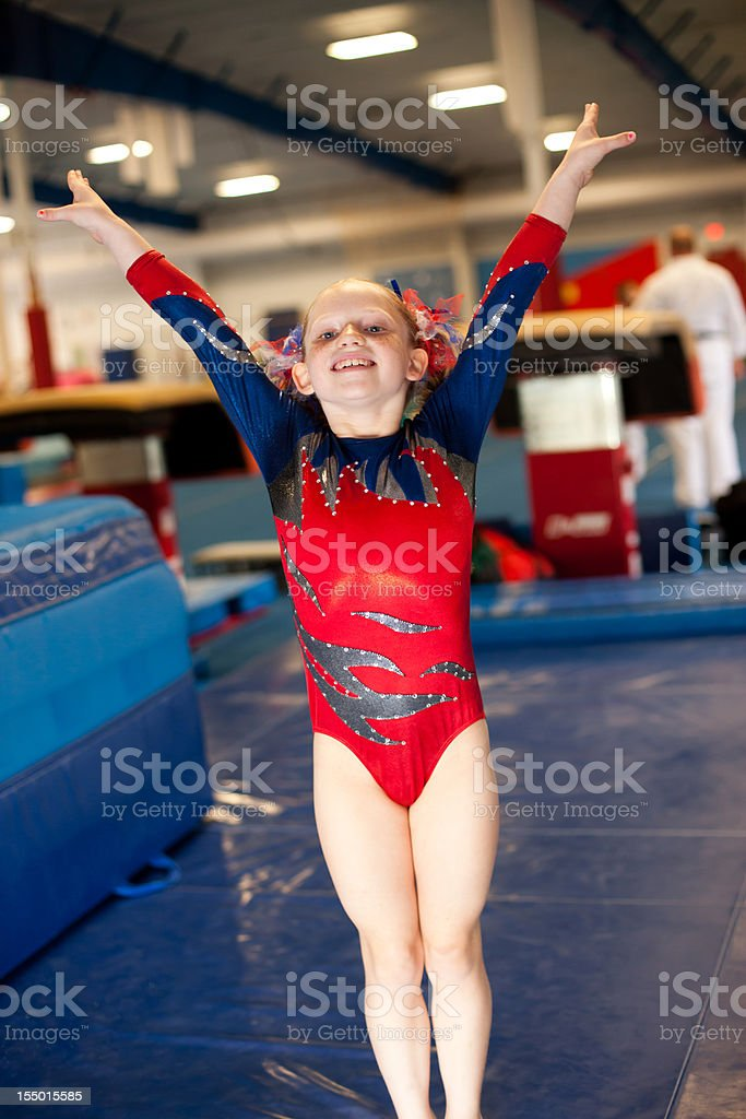 Young Gymnast Posing in Red Blue Leotard royalty-free stock photo