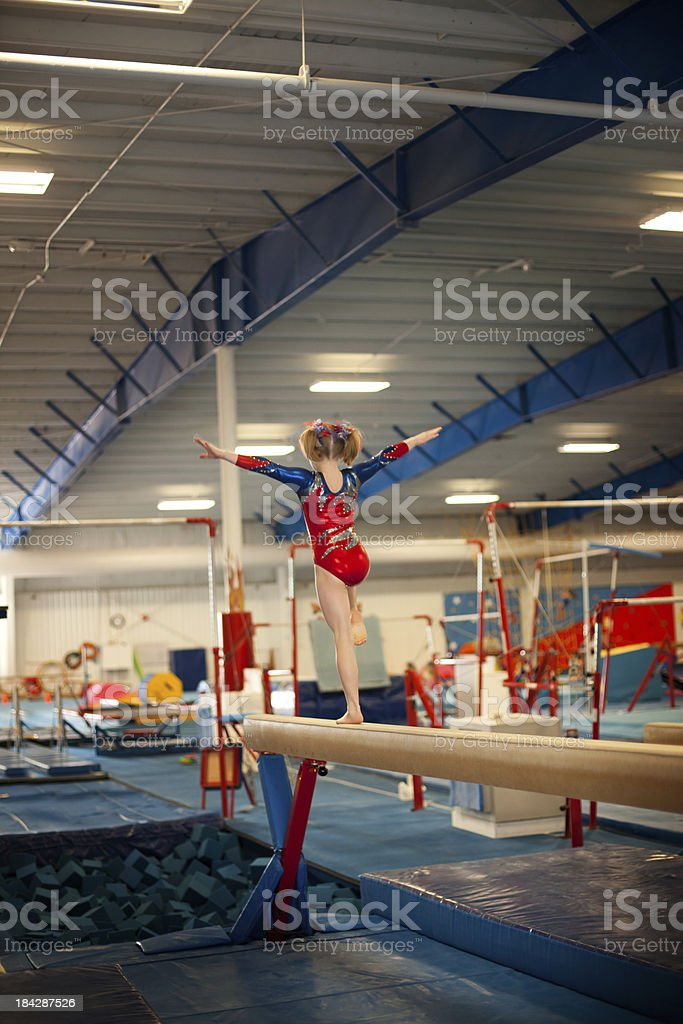 Young Gymnast Practicing on Beam stock photo