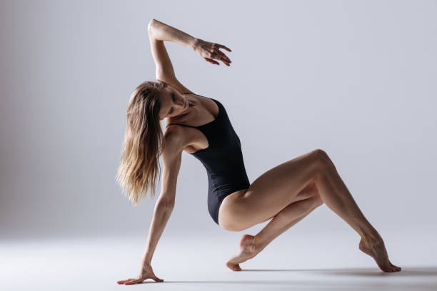 young gymnast woman stretching and training - leotard stock pictures, royalty-free photos & images