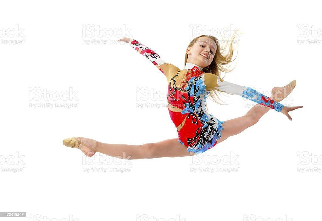 Young gymnastic girl jumping isolated on white stock photo