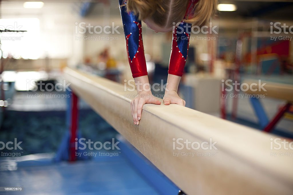 Young Gymnasts Hands on Balance Beam stock photo