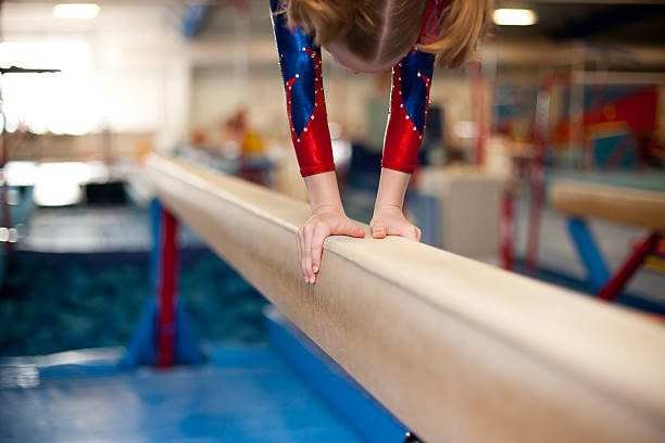 young gymnasts hands on balance beam - uneven parallel bars stock photos and pictures