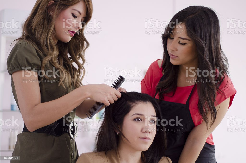 Young hairstylist apprentice at work stock photo