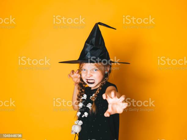 Young halloween witch on orange background with black hat picture id1045448736?b=1&k=6&m=1045448736&s=612x612&h=zko51c0kkxbq91lydjj4leppliri32y9xmir4zzo1i4=