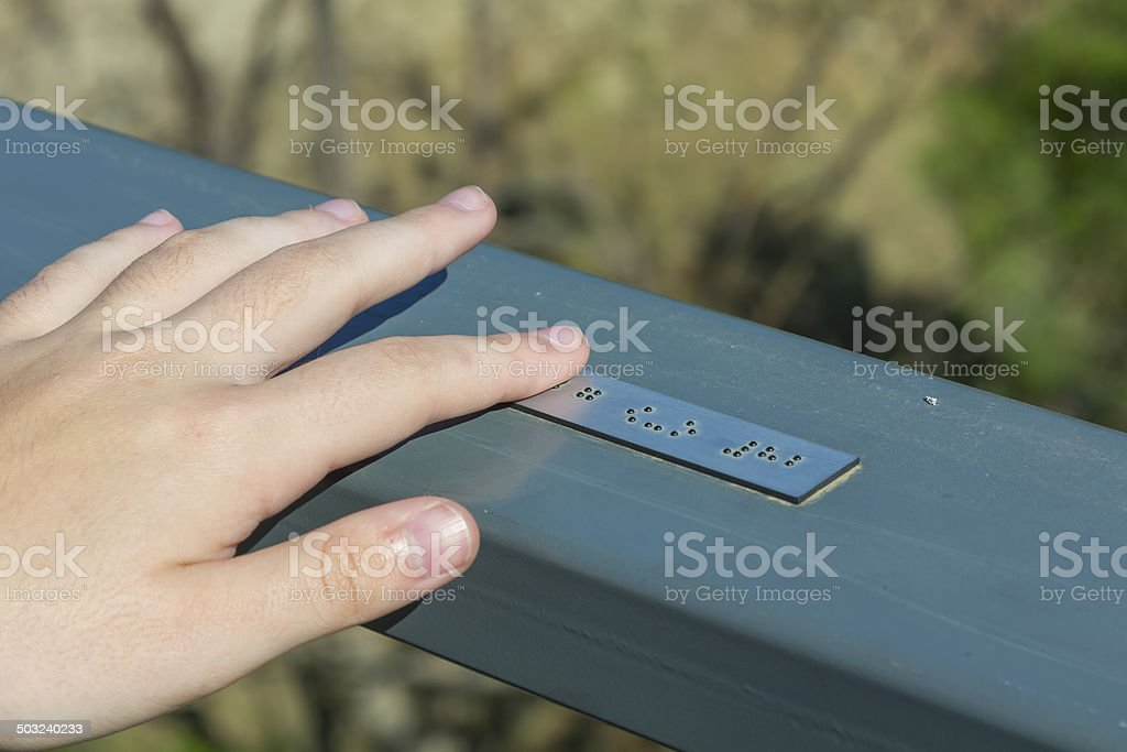 Young hand reading braille writing stock photo