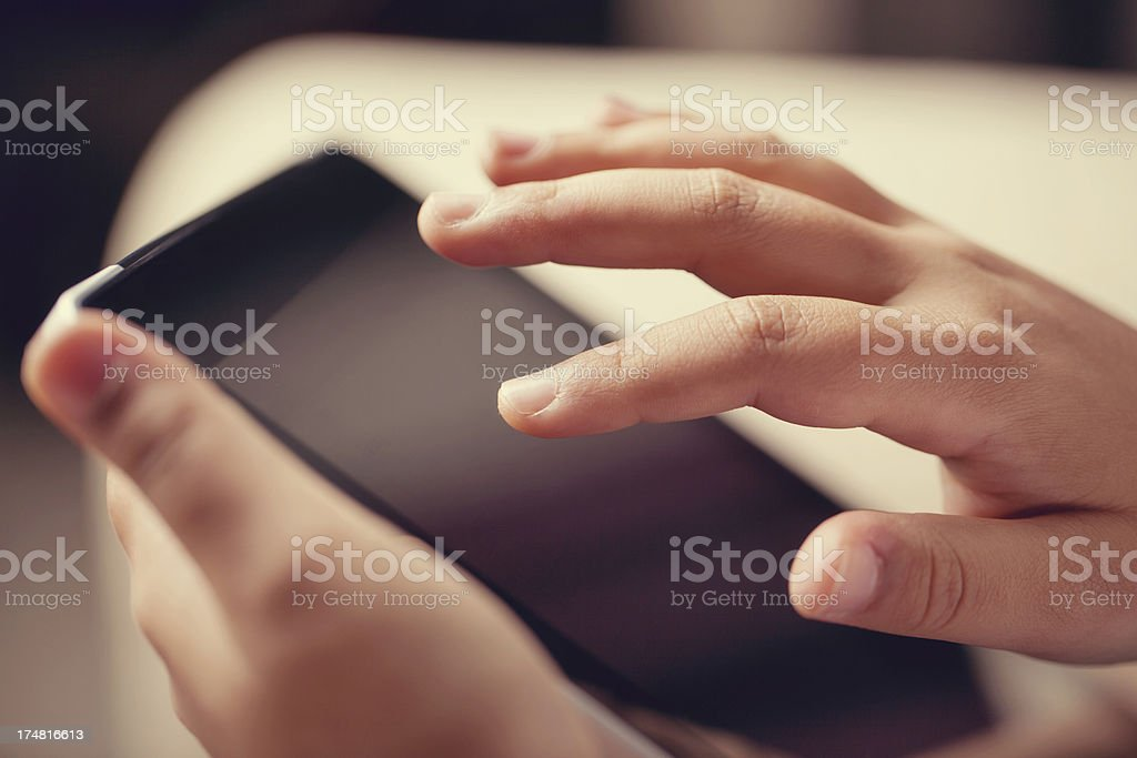 young hands using a digital tablet royalty-free stock photo