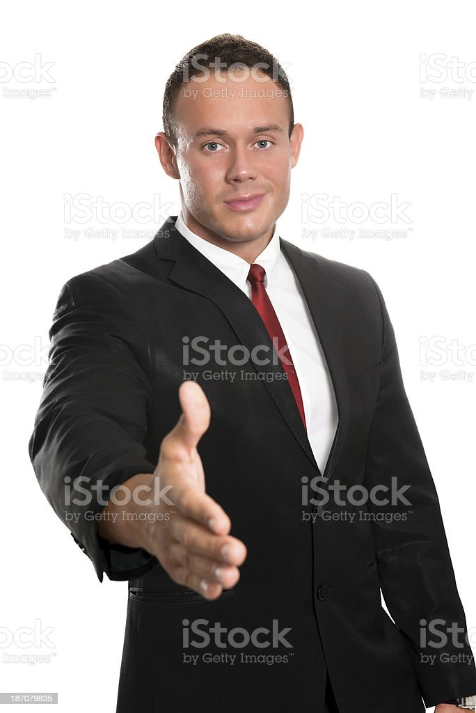 Young Handsome and Confident Businessman Offers Hand royalty-free stock photo