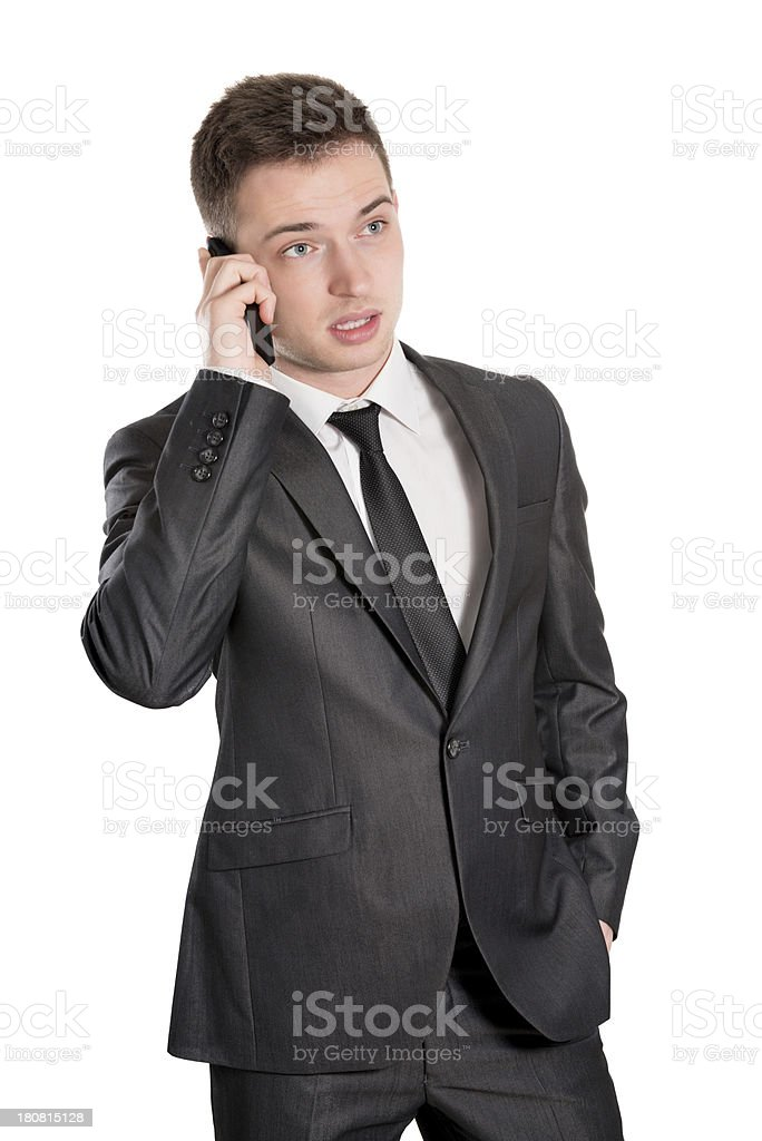 Young Handsome and Confident Businessman Talking on Mobile Phone stock photo