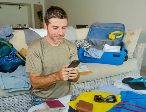 Young handsome and happy man packing travel suitcase at home sofa picture id994767168?b=1&k=6&m=994767168&s=612x612&w=0&h=vf3 iymeuwiwjvcvuun 1dcjadqczyi4awztfv4ohiy=