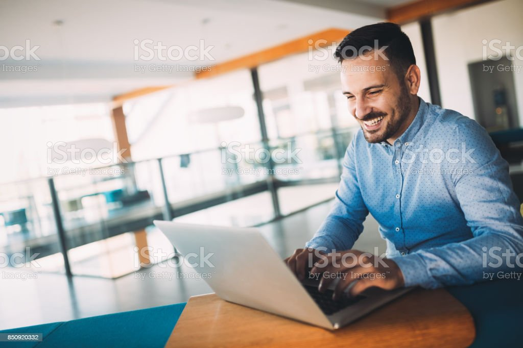 Young handsome architect working on laptop in office royalty-free stock photo