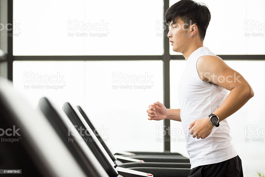 young handsome asian man works out in modern gym young handsome asian man works out in modern gym Active Lifestyle Stock Photo