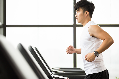 Young Handsome Asian Man Works Out In Modern Gym Stock Photo - Download Image Now
