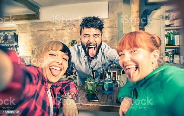 Young handsome bartender flirting with beautiful girls at cocktail picture id473695298?b=1&k=6&m=473695298&s=612x612&h=y4wp4l7zciqc3nm2xtoxuhhmmqvjalgonrhv1abkf0m=