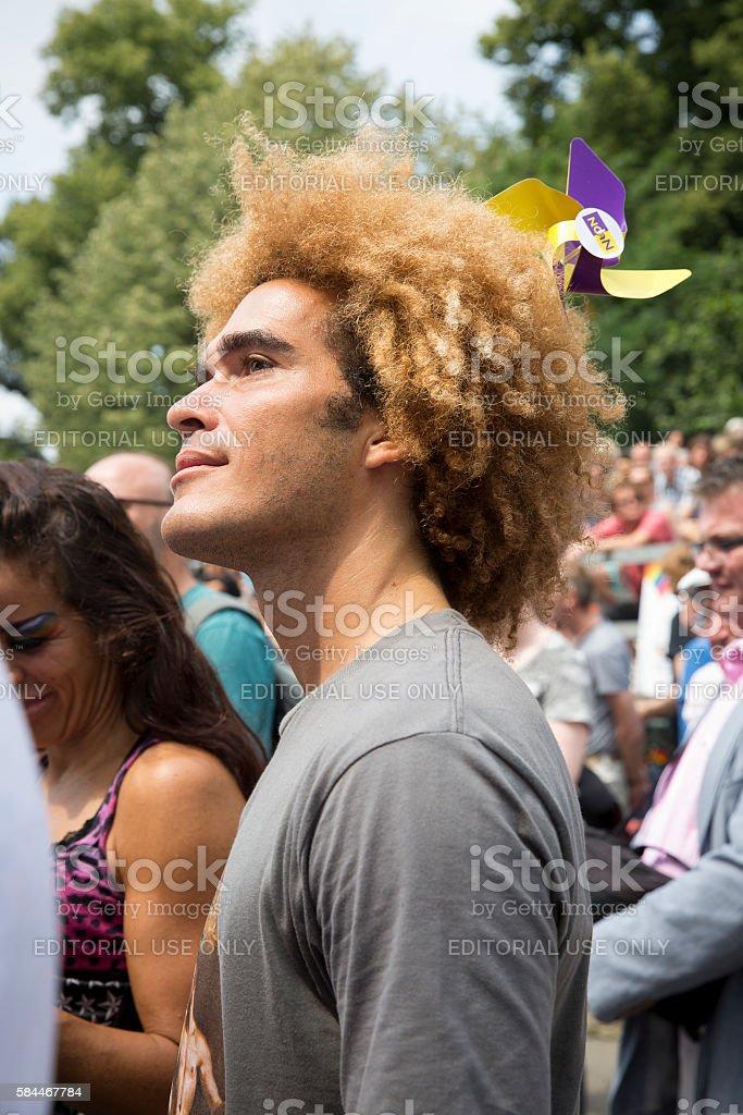 young handsome black man Pink Saturday 2016 Gay EuroPride Amsterdam stock photo