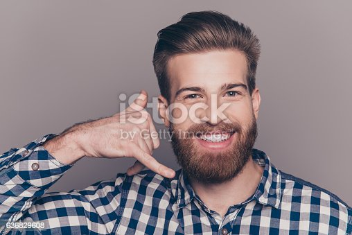 636829368istockphoto Young handsome boyfriend show sight call me with fingers 636829608