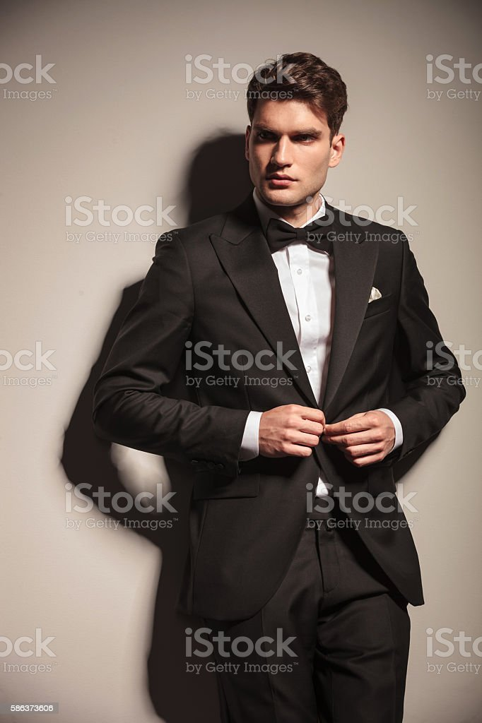 Young handsome business man closing his jacket stock photo