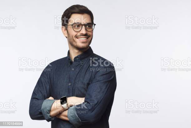 Young handsome business man dressed in casual denim shirt with on picture id1170154554?b=1&k=6&m=1170154554&s=612x612&h=qnbx6re4nu0hwjp3upwxel bs2r2p5ul1db1z6h xb4=