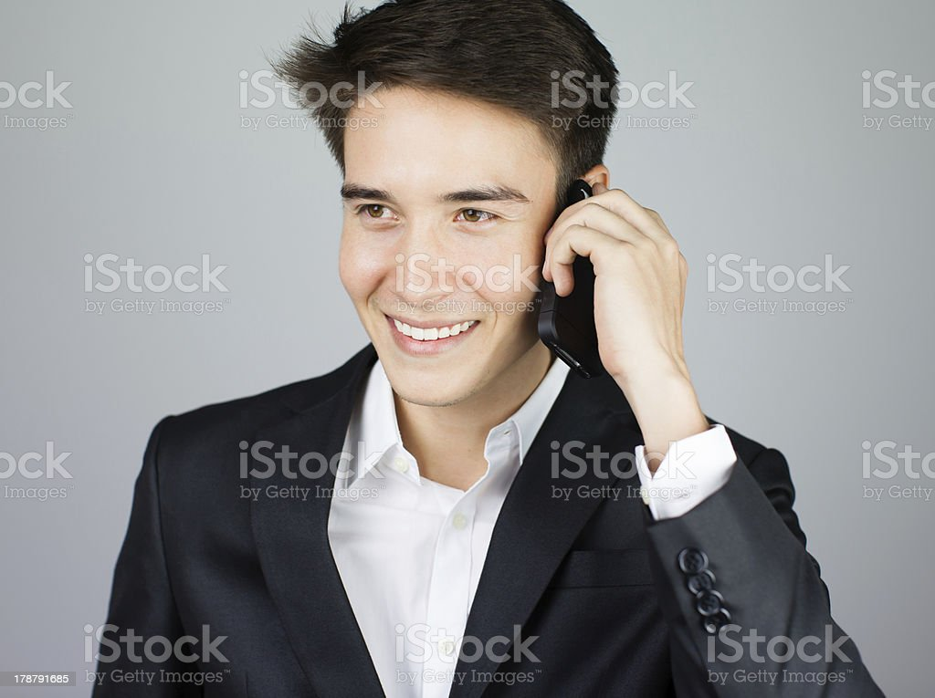 Young handsome business man on smartphone royalty-free stock photo