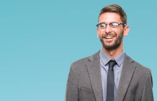 unga stiliga affärsman över isolerade bakgrunden tittar bort till sida med leende på ansikte, naturliga uttryck. skrattande självsäker. - profile photo bildbanksfoton och bilder