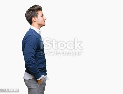 Young handsome business man over isolated background looking to side, relax profile pose with natural face with confident smile.