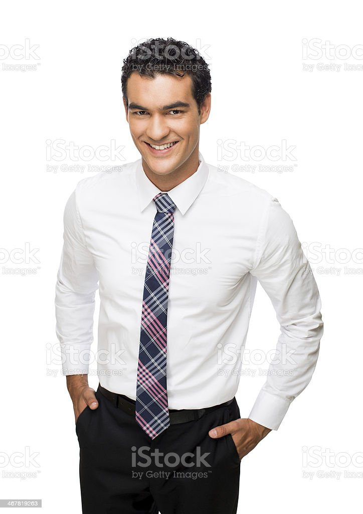 Young handsome business man with hands in pockets stock photo