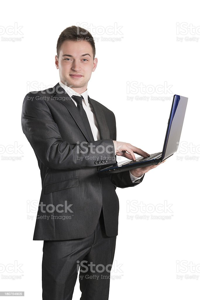 Young Handsome Businessman How Smiling and Using Computer stock photo