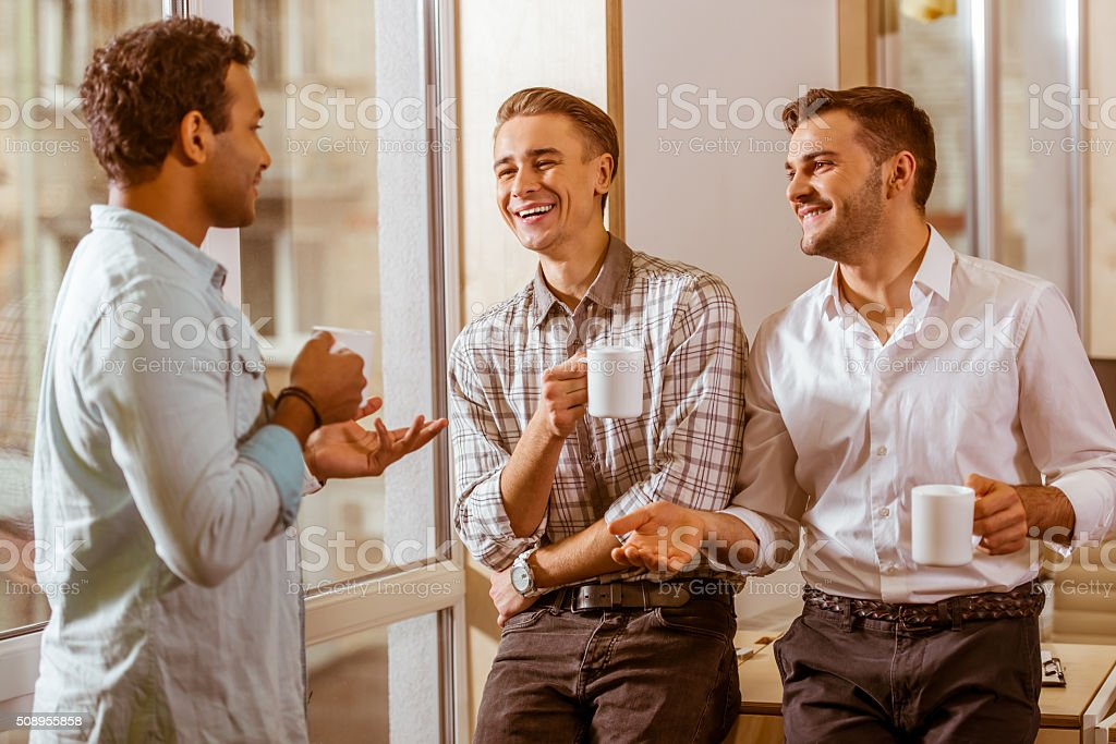 Young handsome businessmen coworking and resting stock photo