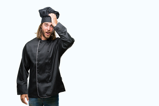 1046559700 istock photo Young handsome cook man with long hair over isolated background surprised with hand on head for mistake, remember error. Forgot, bad memory concept. 1046559700