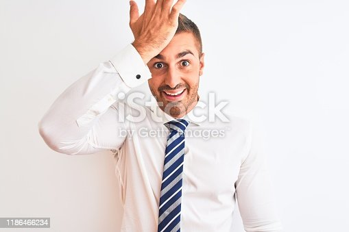 1046559700istockphoto Young handsome elegant business man over isolated background surprised with hand on head for mistake, remember error. Forgot, bad memory concept. 1186466234