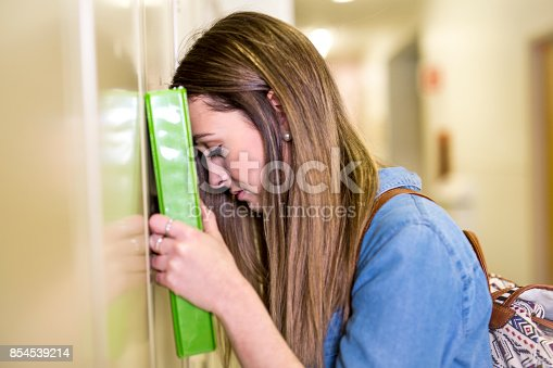 istock A Young handsome female student at the college 854539214