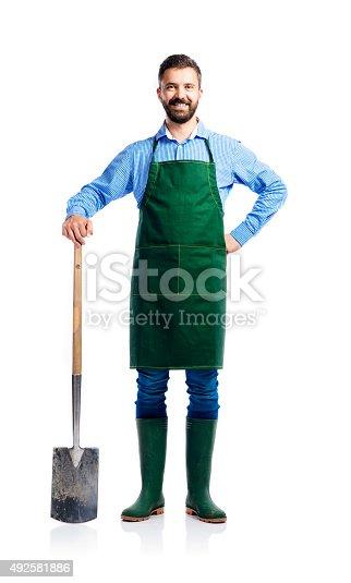istock Young handsome gardener 492581886