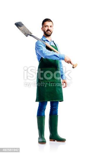 istock Young handsome gardener 492581942