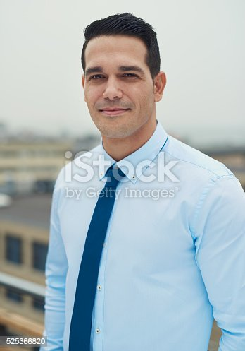 istock Young handsome Hispanic man on a rooftop 525366820