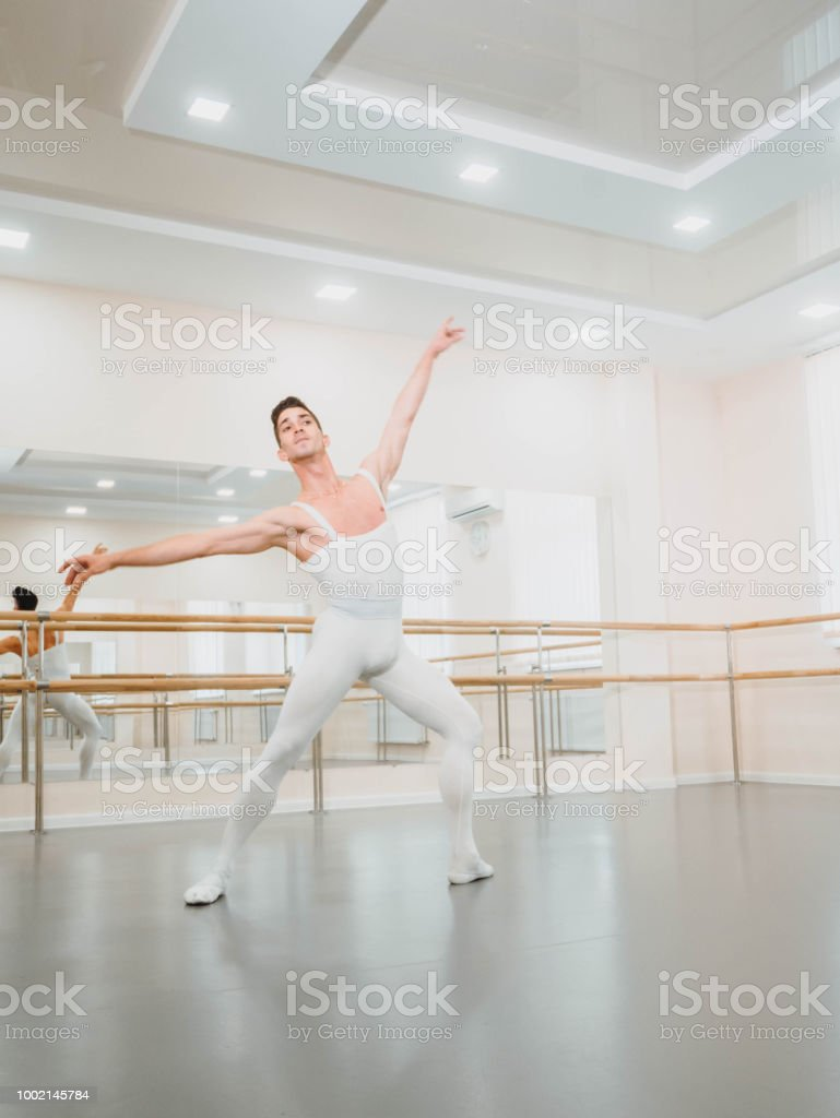 Young Handsome Male Dancer Practicing In Classical Ballet In Small Studio With Mirrors Man In White Tights Professional Choreographer Is Working On Creating Performance Stock Photo Download Image Now Istock