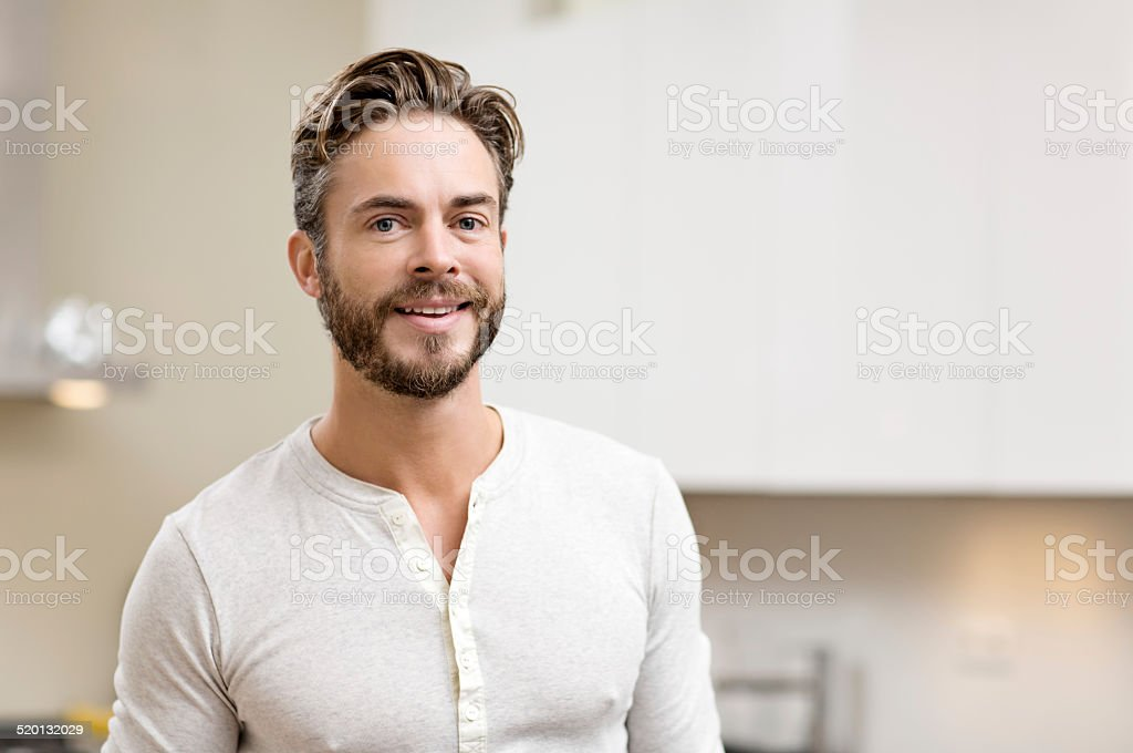 Young handsome man at home in the morning. stock photo