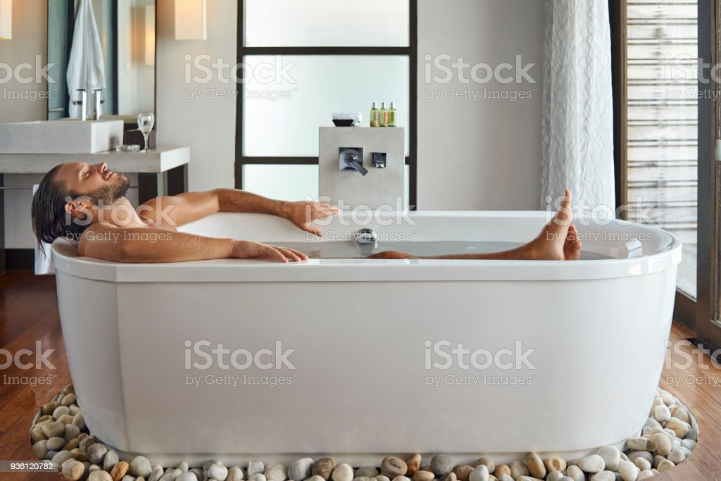 young handsome man enjoying in the bathtub royalty-free stock photo