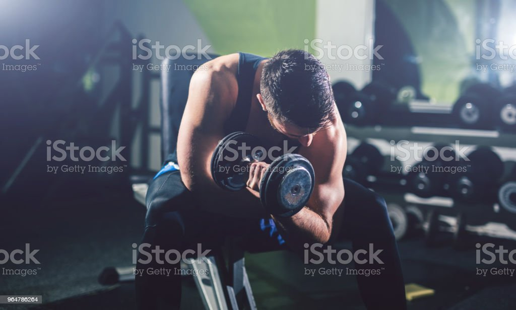 Young handsome man exercise in the gym. royalty-free stock photo