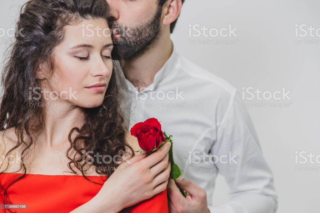 A Young Handsome Man Gently Covers His Beautiful Wife