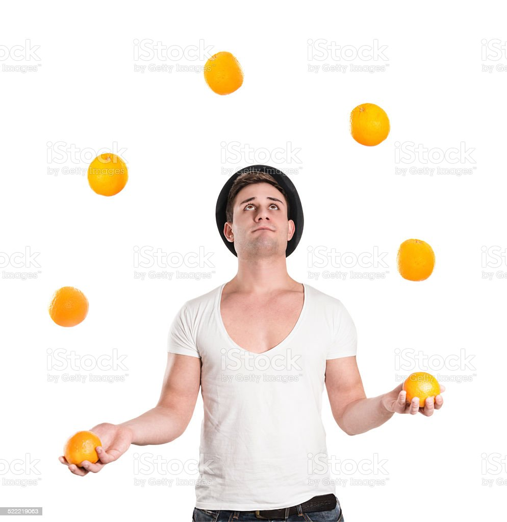 Young Handsome Man How Juggling with Oranges stock photo